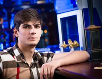 Portrait of a young man at the bar Stock Photos