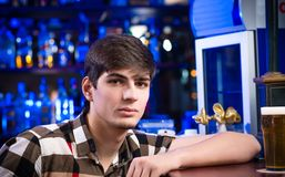 Portrait of a young man at the bar Royalty Free Stock Images