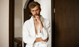 Portrait of young man in bathrobe. royalty free stock photo