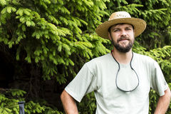 Portrait of young man with beard and hat in a mountain pine fore Stock Photography