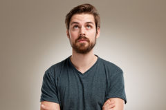 Portrait of young man with beard, looking up straight Royalty Free Stock Images