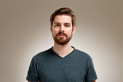 Portrait of young man with beard. On neutral background Stock Photography