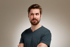Portrait of young man with beard, think about Royalty Free Stock Photo