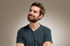 Portrait of young man with beard, think about Stock Photos