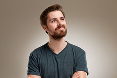 Portrait of young man with beard, think about Stock Images