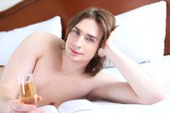 Portrait of a young man in bed Royalty Free Stock Photo