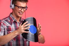 Portrait of young man bending disk and wearing headphones. Stock Photography