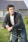 Portrait of young man on bicycle outdoors Royalty Free Stock Photo