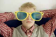 Portrait of young man in big glasses Royalty Free Stock Image