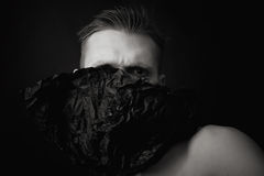 Portrait of a young man on a black background Royalty Free Stock Photos