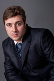 Young man in a black suit Royalty Free Stock Photography