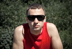 Portrait of young man in black  sunglasses Royalty Free Stock Photo
