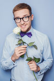 Portrait a young man in blue shirt with white rose. Date, birthday, Valentine Royalty Free Stock Images