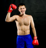 Portrait of young man with boxing  gloves Royalty Free Stock Image