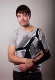 Portrait of young man with broken hand Stock Photo
