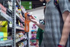 Portrait of young man buying somee sports nutrition in the store royalty free stock photo