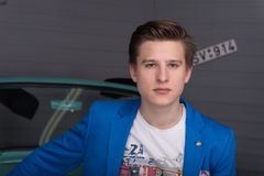 Portrait of a young man in the car garage Royalty Free Stock Image