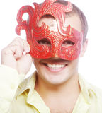 Portrait of young man with carnival mask Royalty Free Stock Photo