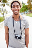 Portrait Of Young Man Carrying Camera Royalty Free Stock Photography