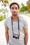 Portrait Of Young Man Carrying Camera Stock Image