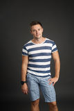 Portrait of young man in casual striped shirt royalty free stock images