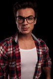 Portrait of a young man in checkered shirt and glasses Royalty Free Stock Photography