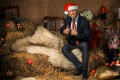Portrait of young man in Christmas interior Royalty Free Stock Image