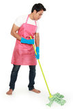 Portrait of young man with cleaning equipment. Mopping the floor isolated over white background Stock Photos