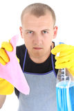 Portrait of young man with cleaning supplies Stock Photo