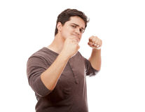 Portrait of young man with clenched fist Stock Images