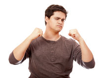 Portrait of young man with clenched fist Royalty Free Stock Photography