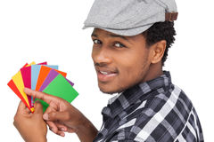 Portrait of a young man with colorful papers Royalty Free Stock Image