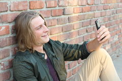 Portrait of a young man connecting with somebody via a video call Royalty Free Stock Images