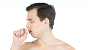 Portrait of young man coughing because of flu. stock photos