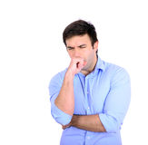 Portrait of young man coughing isolated on white Stock Images