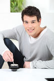 Portrait of a young man with cup of coffee Stock Images