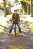 Portrait Of Young Man With Cycle In Autumn Park Royalty Free Stock Images