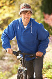 Portrait Of Young Man With Cycle In Autumn Park Stock Photo