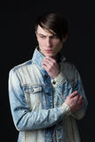Portrait of a young man in a denim jacket Stock Photo