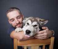 Portrait of a young man with a dog Stock Images