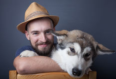 Portrait of a young man with a dog Royalty Free Stock Photo