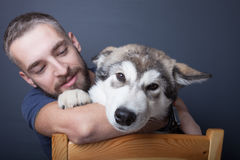 Portrait of a young man with a dog Royalty Free Stock Photography
