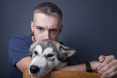 Portrait of a young man with a dog Royalty Free Stock Images