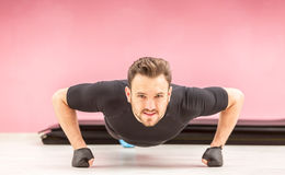 Portrait of a Young Man Doing Pushups Royalty Free Stock Images