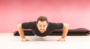 Portrait of a Young Man Doing Pushups Royalty Free Stock Photography