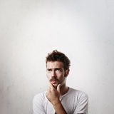 Portrait of a young man in doubt Royalty Free Stock Images