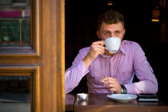 Portrait of a young man drinking coffee. Royalty Free Stock Photos