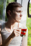 Portrait of young man drinking tea Royalty Free Stock Photo