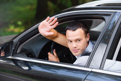 Portrait of young man driving car Stock Photography