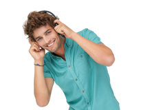 Portrait of a young man enjoying music Stock Photos